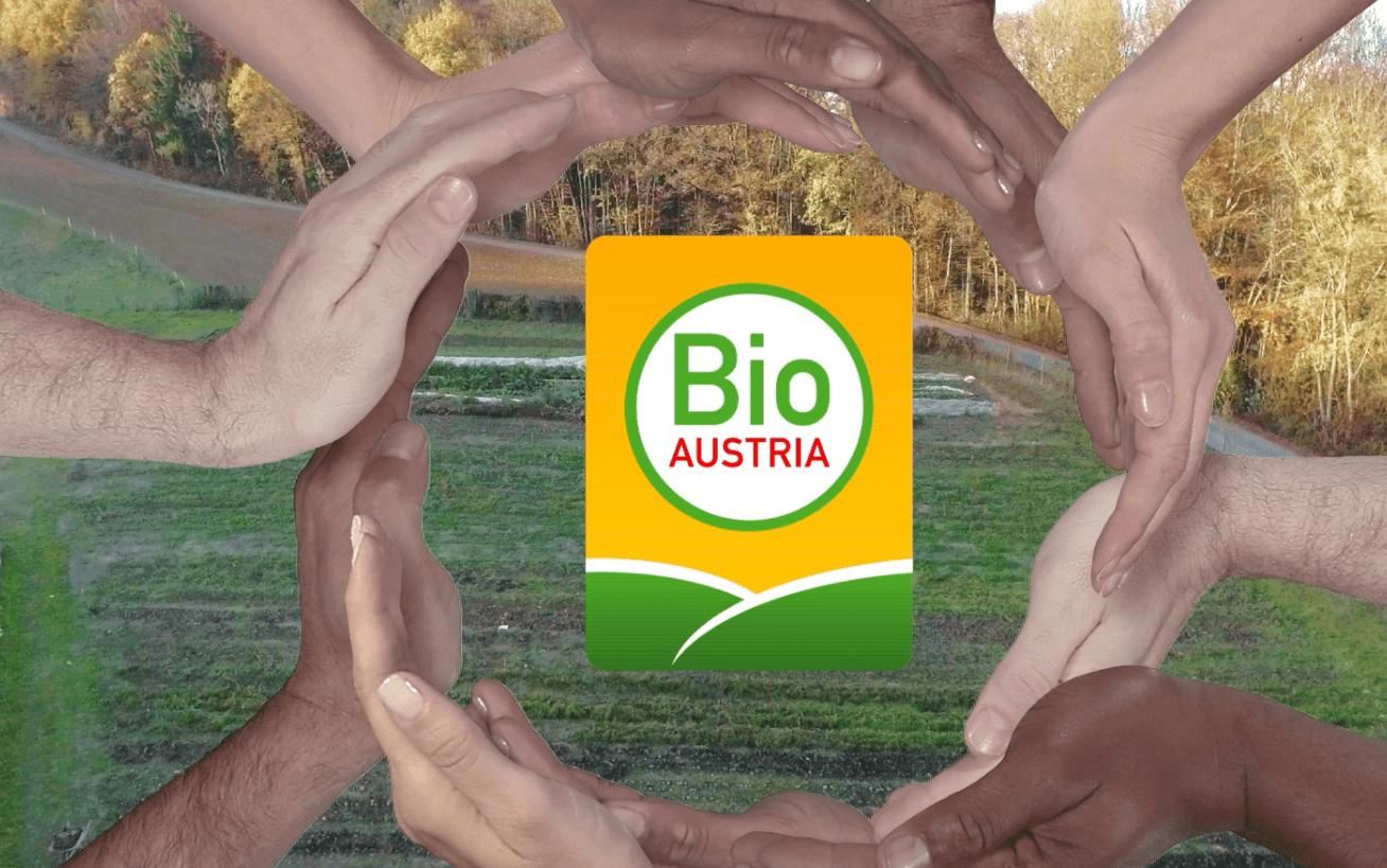 Bio Austria Logo umringt von Händen
