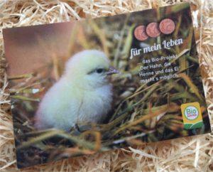 Bild vom Postkarte auf Stroh.